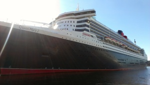 The Queen Mary 2, standing proud at Pier 88 in New York on a sun-kissed September morning.