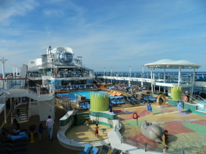 """The outdoor mid-ship pool area on Deck 14 has a zero-entry children's pool and an outdoor movie screen. Unfortunately, the pool isn't deep enough to accommodate the famous """"Men's International Belly-flop Competition""""."""