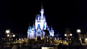 """Cinderella Castle is the Magic Kingdom's crowning jewel, with the """"Partners"""" statue of Walt Disney and Mickey Mouse in the forefront."""