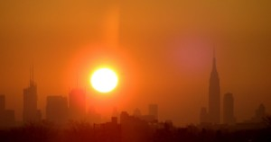 The sun rising over the New York City skyline. How strange it was to see it returning home from work.